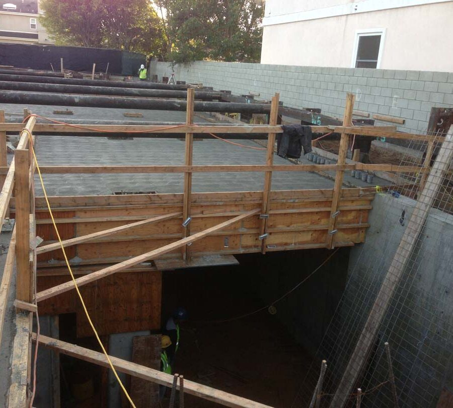 Prior to working on this home's foundation shoring was placed to create a safe work environment. Pacificland Constructors