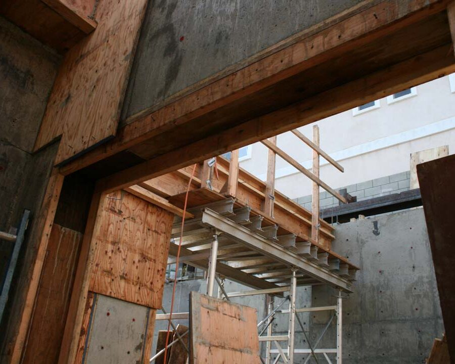 New solid concrete shear walls and retaining walls holding the 1st floor above the basement. Pacificland Constructors