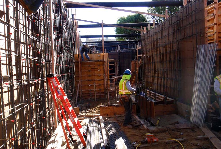 Form work and ironwork for a poured in place retaining wall and basement. Pacificland Constructors