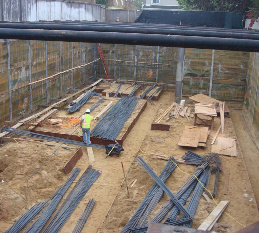 Excavated strip footings are ready for steel reinforcement. Iron men Move in ! Pacificland Constructors
