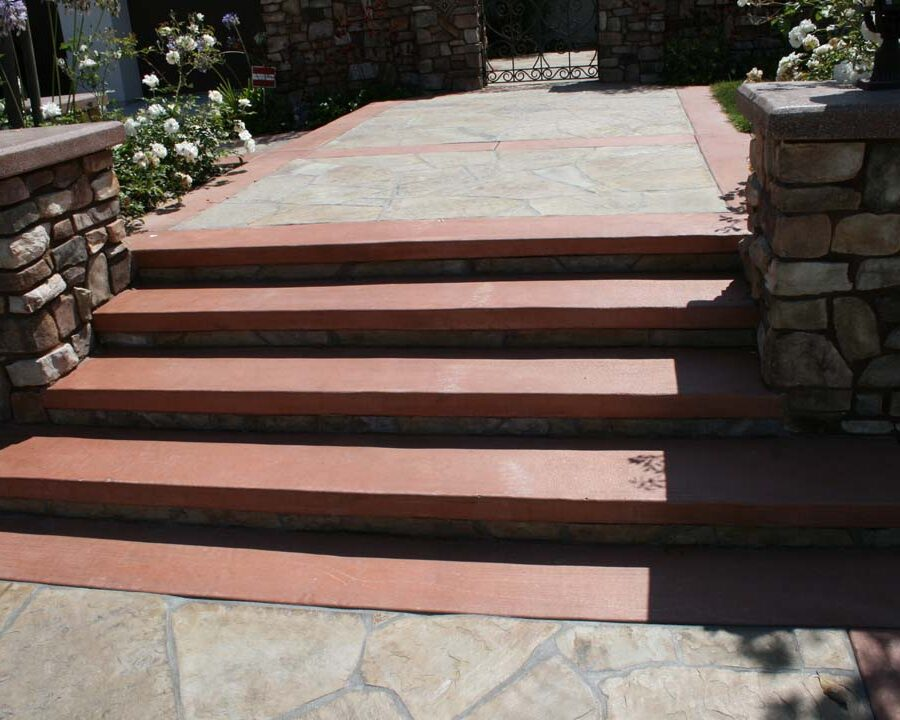 New Steps and flagstone flatwork with concrete ribbons for the entrance of this home. Stone veneered pilasters and colored wall caps create a bold vintage Spanish theme. Pacificland Constructors