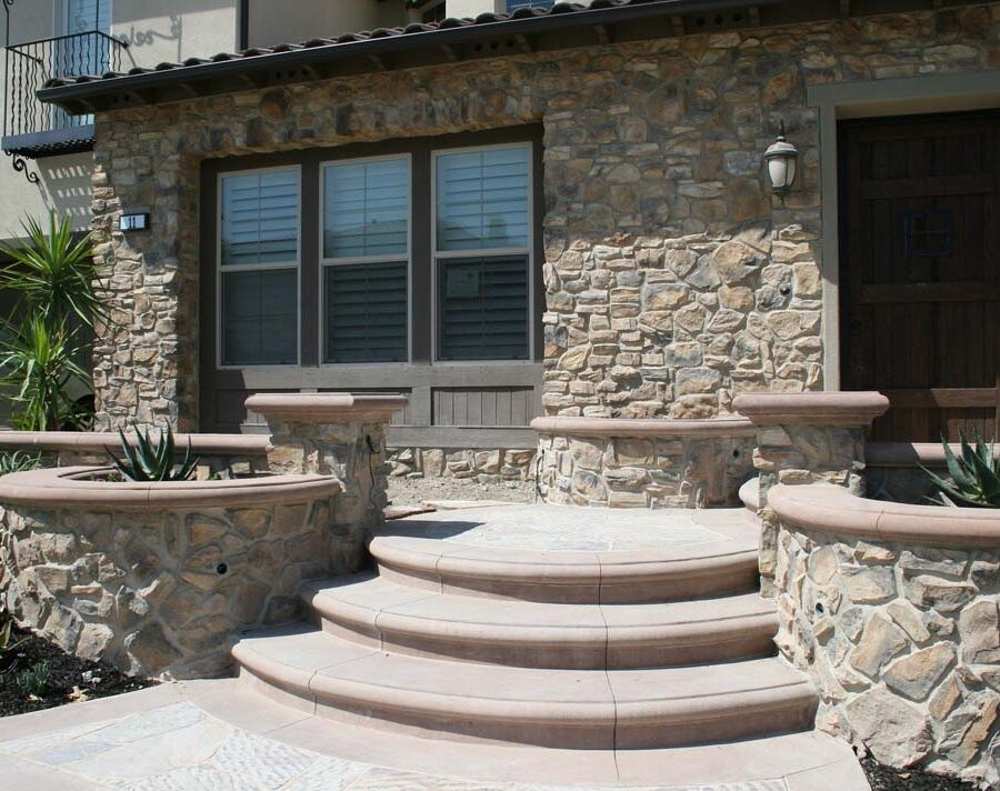 New natural stone veneer on the main entrance of the home creates an architecturally bold and vintage look. Pacificland Constructors