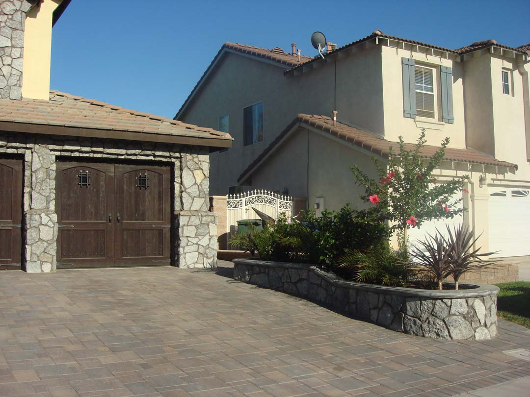 Existing stucco was removed and replaced with new stone veneer to give the home an architecturally vintage look. New planters with concrete precast wall caps match are used to match the vintage theme. Pacificland Constructors