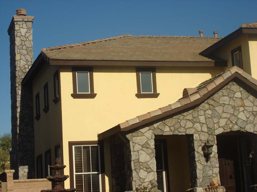 Existing stucco was removed and replaced with new stone veneer to give the home an architecturally vintage look. The existing chimney was repaired, reinforced, and flagstone veneer was used to match the vintage theme. Pacificland Constructors