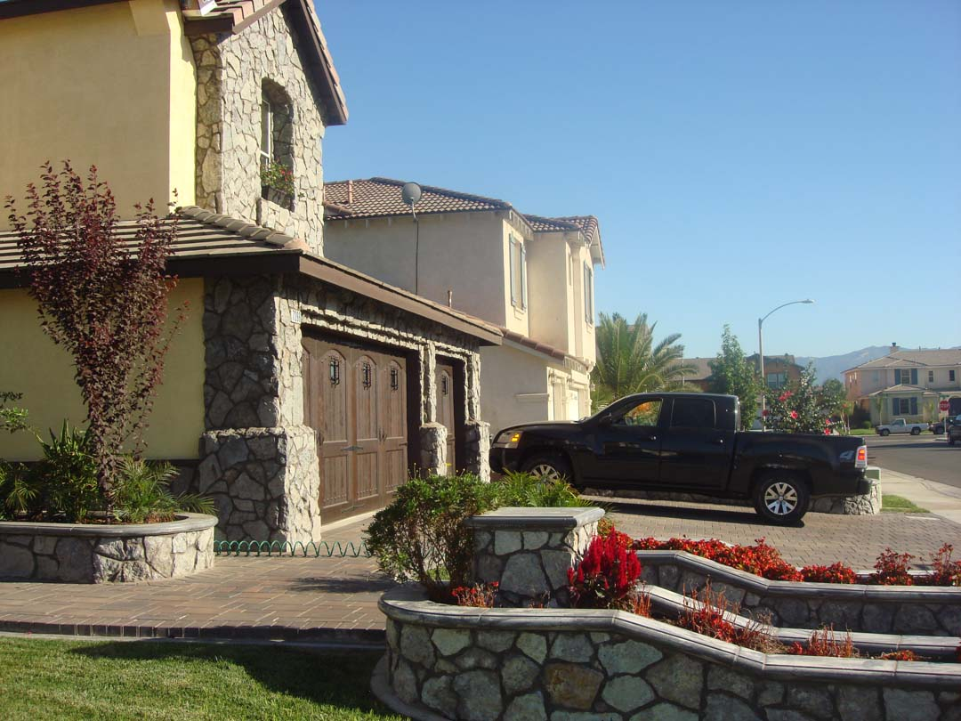 Existing stucco was removed and replaced with new stone masonry to give the home an architecturally vintage look. Pacificland Constructors