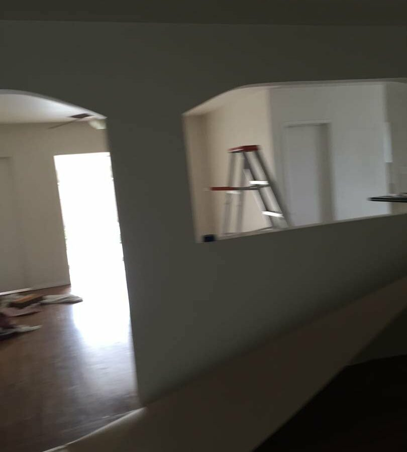 Image of the load bearing wall that will be removed to create an open spaced room.