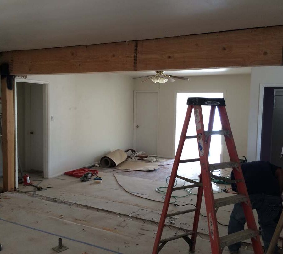 Construction of the replacement of a load bearing wall with a beam. Here the framework has been installed and the load bearing wall has been removed.