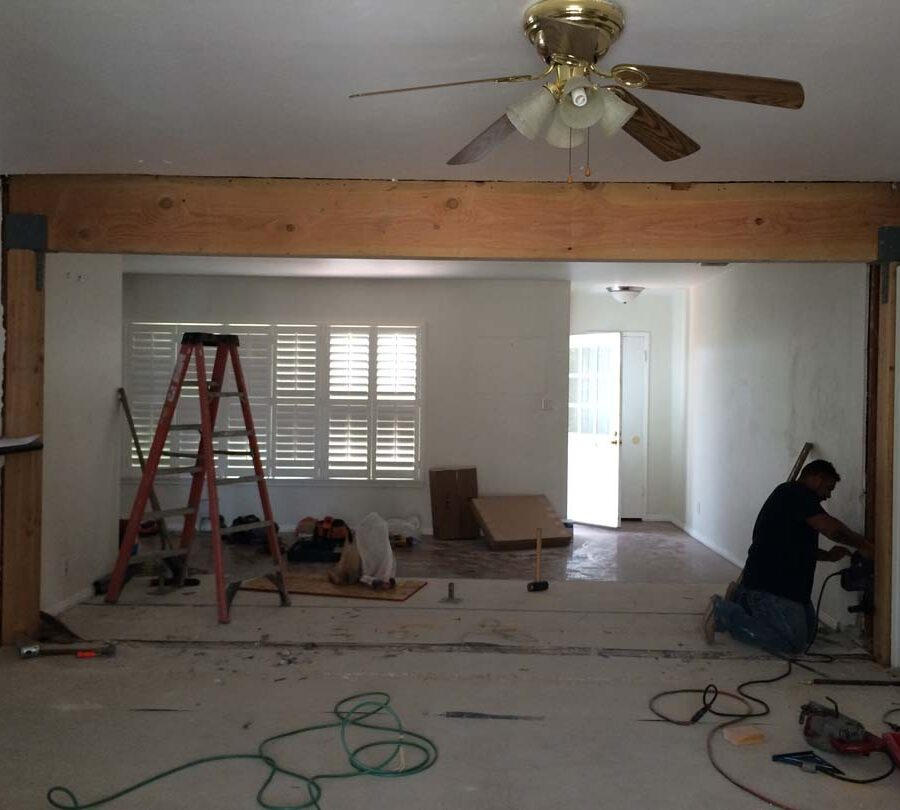 Construction of the replacement of a load bearing wall with a beam. Plaster and drywall needs to be applied prior to sanding and painting.