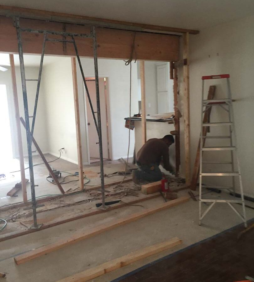 Construction of the replacement of a load bearing wall with a beam. Here the ceiling joists are being supported by removable lally columns in order to raise and install the new load bearing Beam.