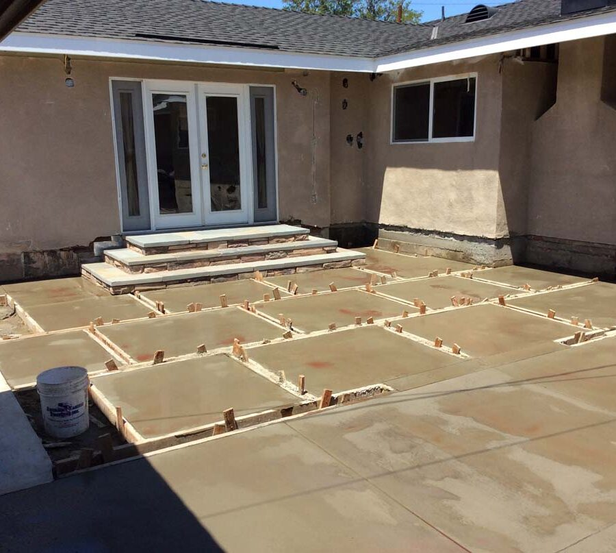 New concrete backyard patio with an architecturally nature-friendly theme. Pacificland Constructors