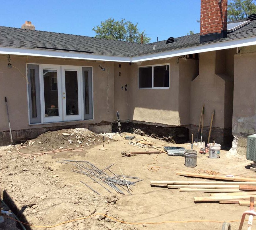 Construction of a new concrete backyard patio with an architecturally nature-friendly theme. Pacificland Constructors