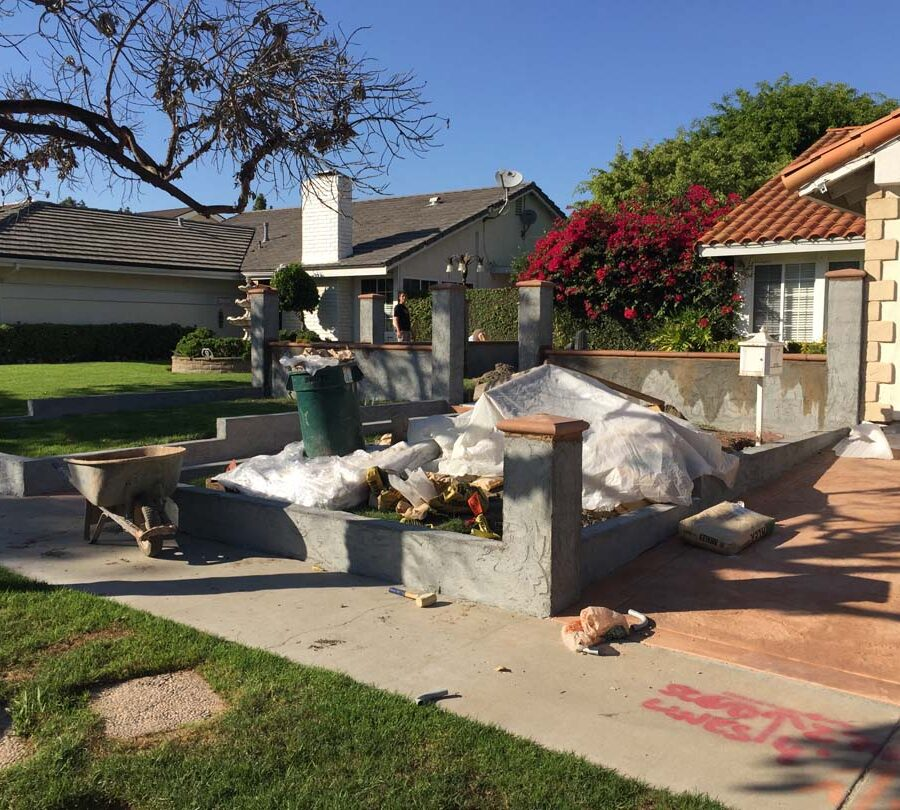 Stucco coating over CMU pilasters and walls for the a courtyard entrance of a home in Cerritos, CA.