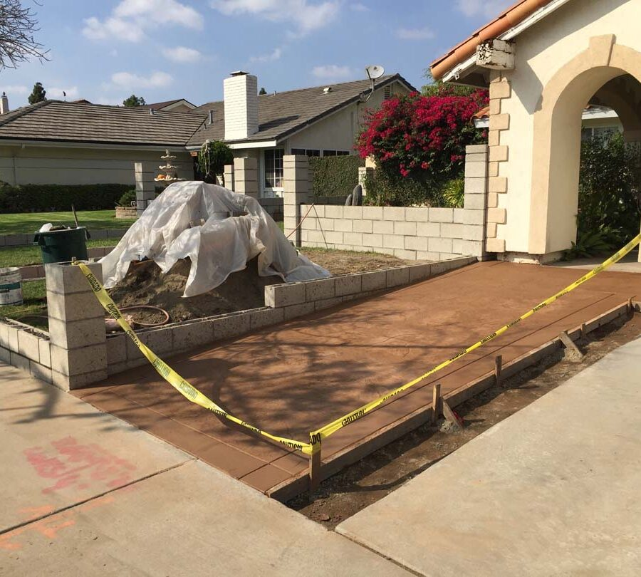 New CMU courtyard in Cerritos, CA. This will have a colored stucco coat so it contrasts with the stamped colored concrete.