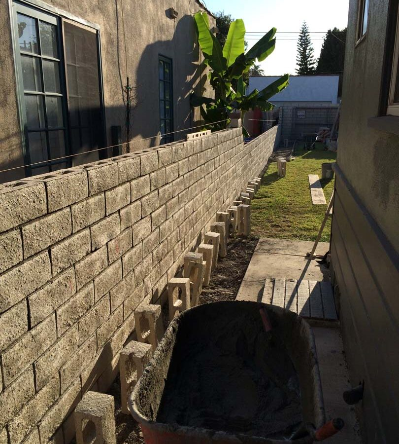 Construction of a new slump block wall for a home's side yard. This is a great option to raise the value of your home and create more private living space. Pacificland Constructors