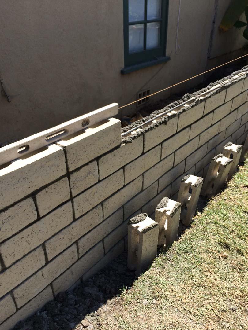 Cmu slump block wall long beach 90807 contractor masonry for Slump block construction