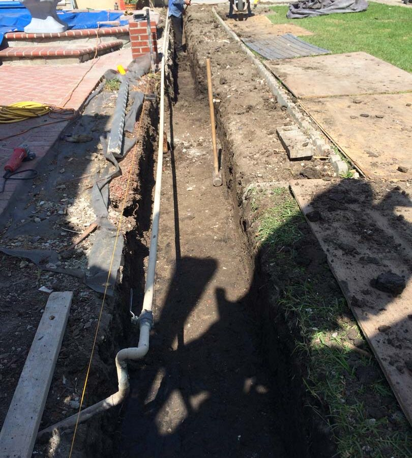 New strip footing for a new slump block wall for a home's side yard. Iron-men will now tie steel reinforcement for this wall. Pacificland Constructors