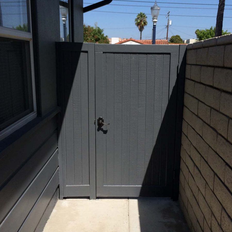 New slump block CMU wall with a wall cap for a home's backyard. This is a great option to raise the value of your home and create more private living space. It also has access to the front yard making it convenient to store and haul out trash bins. Pacificland Constructors