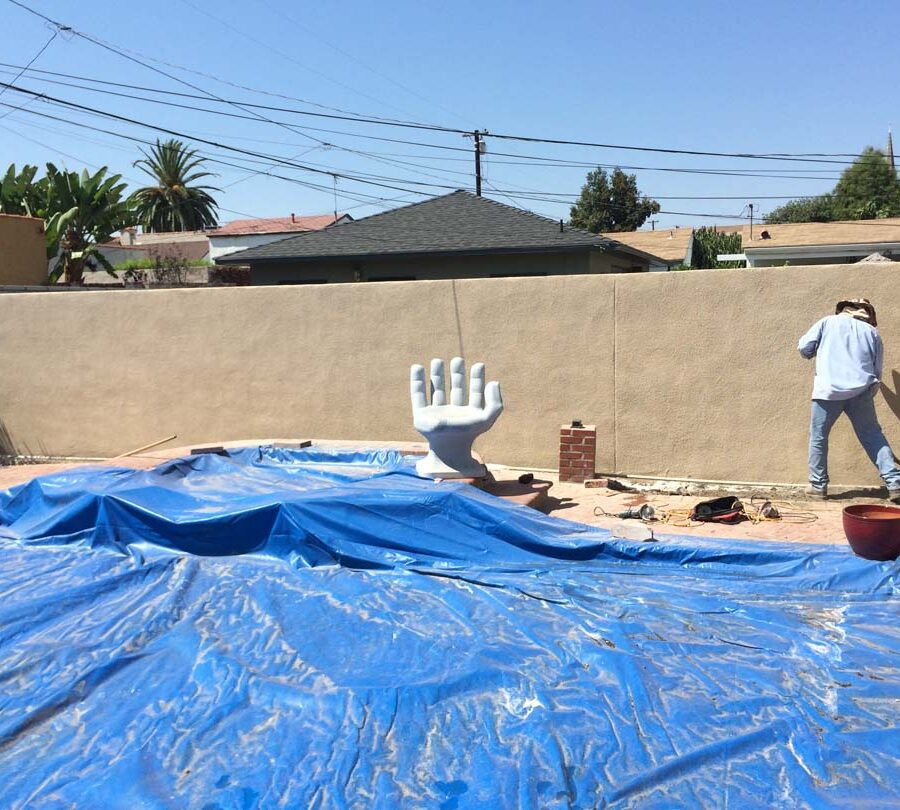 The neighbor of our client wanted us to apply colored stucco to his side of the wall. Our crew was happy to do that for them. Pacificland Constructors
