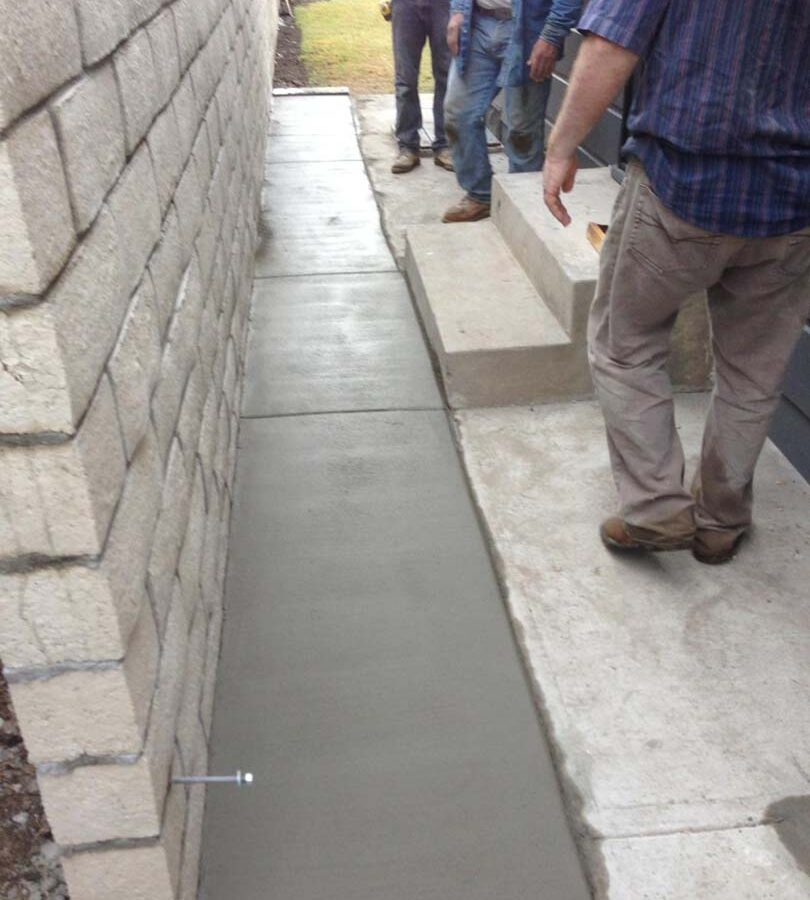 The owner wanted to keep his existing sidewalk and only extend it to the wall for this reason the entire sidewalk was not poured. Pacificland Constructors