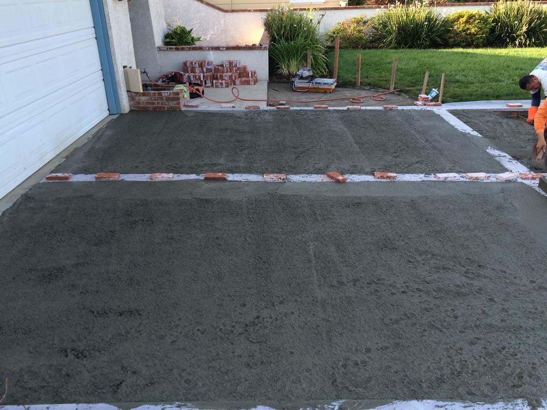 Concrete driveway brick ribbon lomita 90717 contractor for Pouring concrete driveway