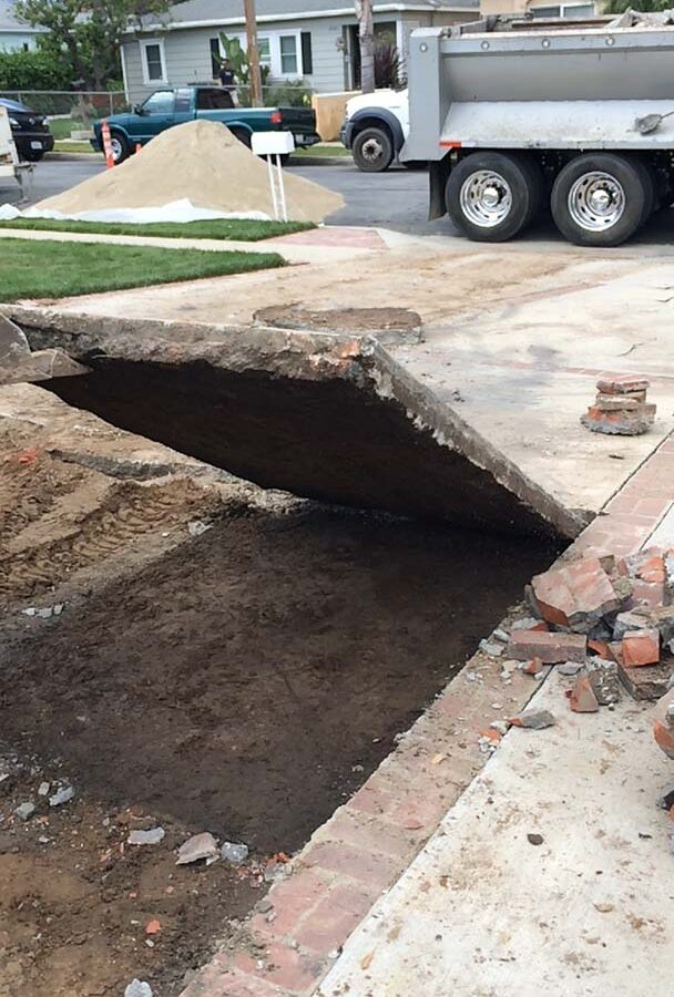 Demolition of outdated driveway.