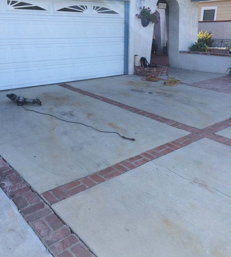 The outdated driveway that was demolished a replaced with a new one.