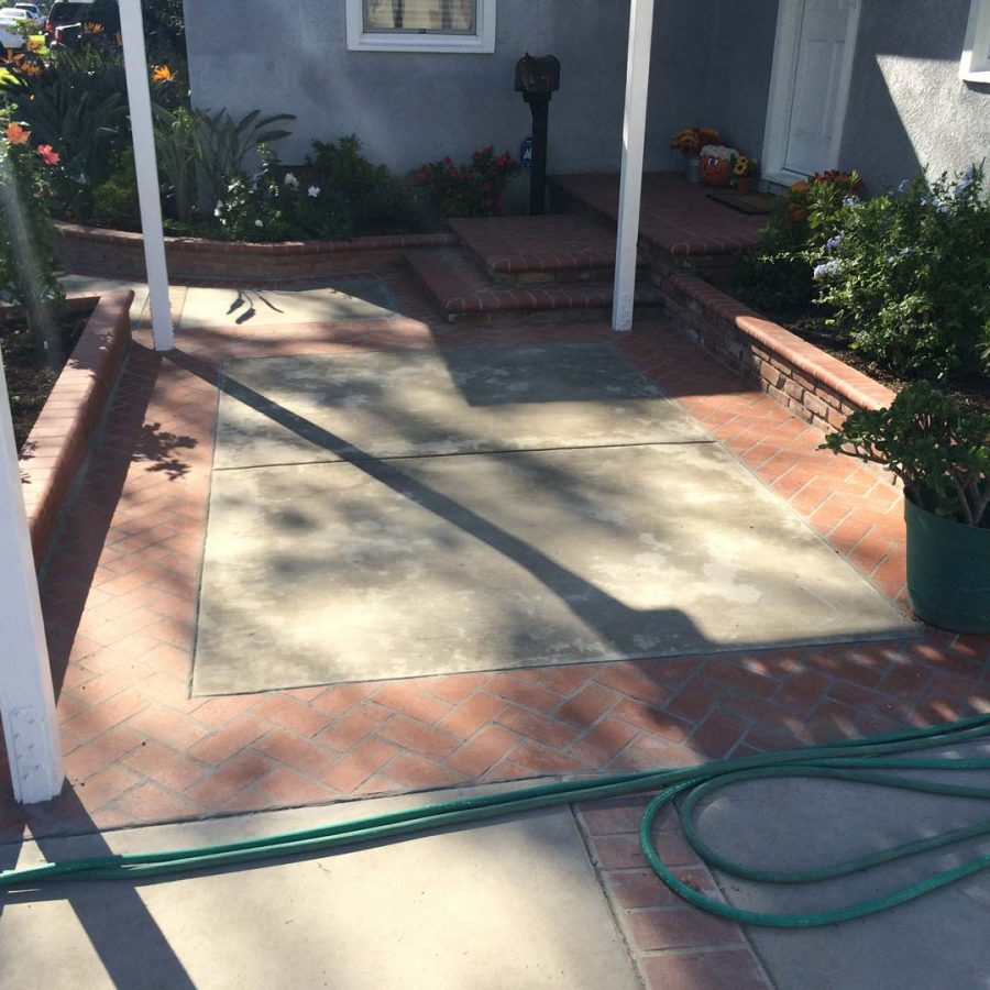New concrete slab with brick ribbon and new brick finish steps. Pacificland Constructors