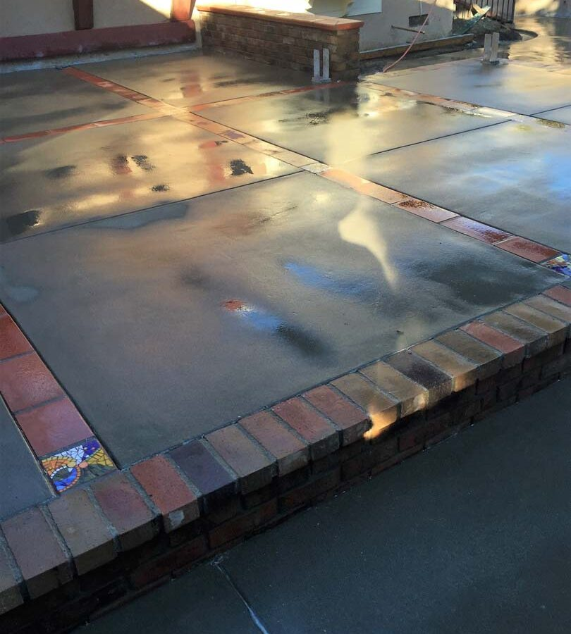 New concrete flatwork with brick ribbon and CBS44's for a new patio cover.