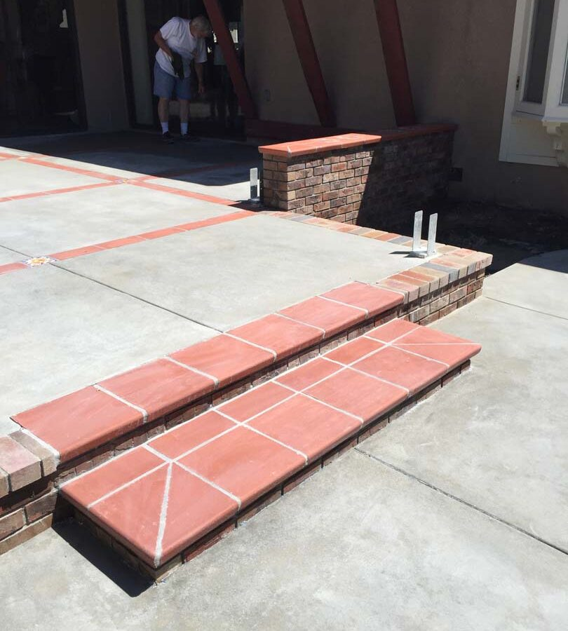 New Broom Swept Gray Concrete Patio With Brick Ribbons And Bull Nosed Brick  Steps.