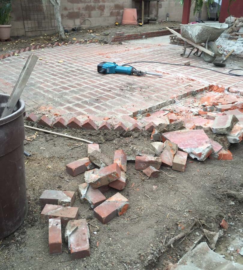 Demolition of the old backyard patio.
