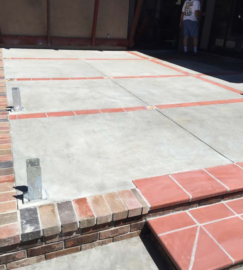 New brick steps, ribbons, and concrete flatwork. Pacificland Constructors