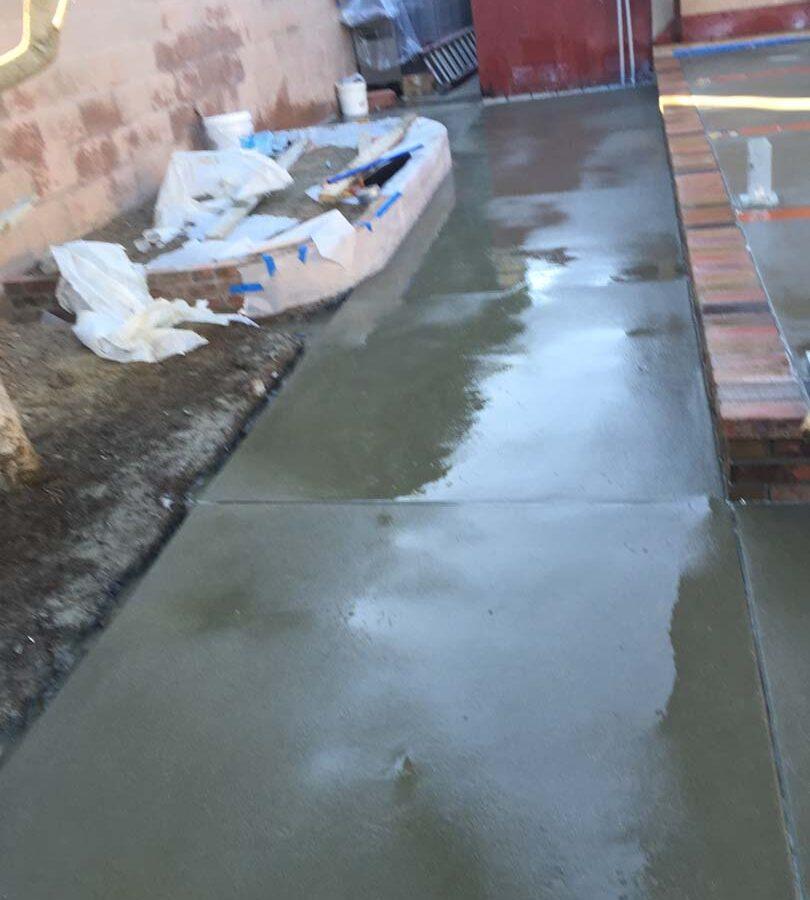 New concrete sidewalk flatwork. Pacificland Constructors