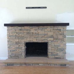 New stone veneer over the existing fireplace to create a vintage theme for the home.
