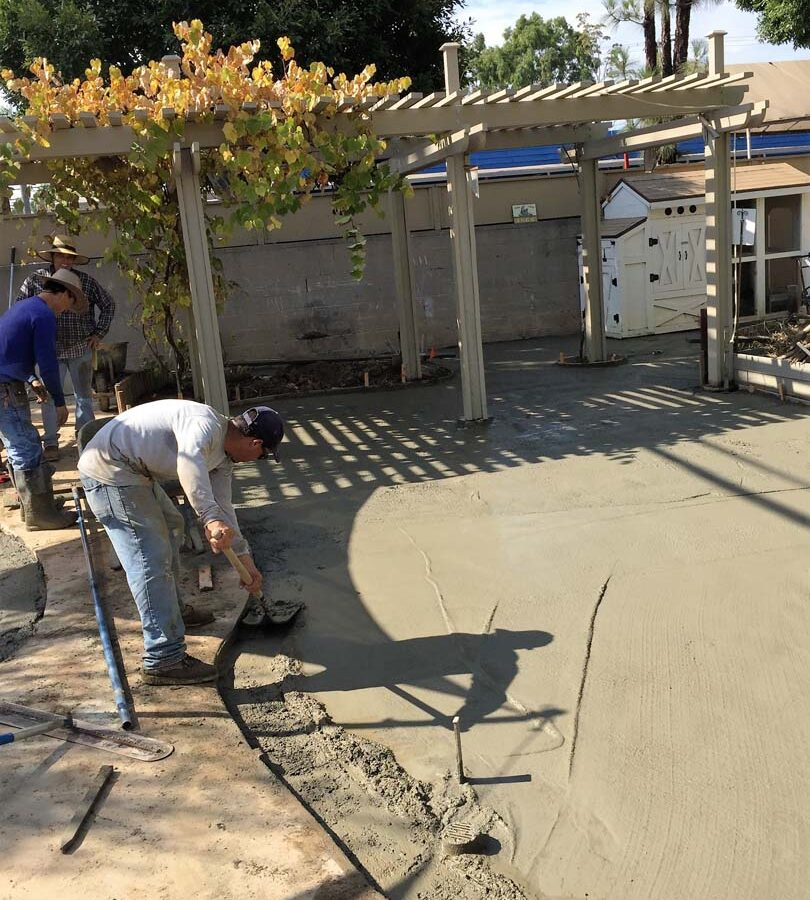 Pouring of a new patio foundation for new pavers. Pacificland Constructors