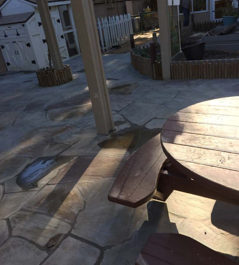 New flagstone patio gives the home a relaxing theme.