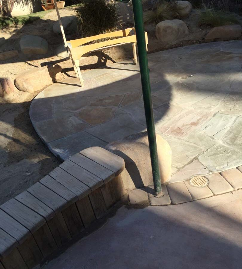 Flagstone patio gives the home a relaxing theme. Pacificland Constructors