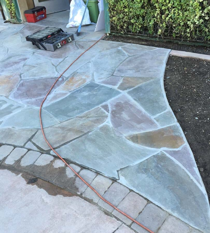 New flagstone patio gives the home a relaxing theme. Pacificland Constructors