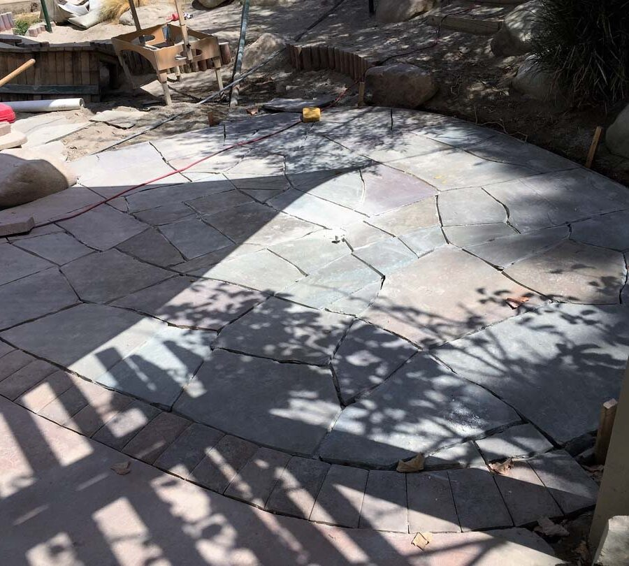 Construction of a flagstone patio gives the home a relaxing theme. Pacificland Constructors