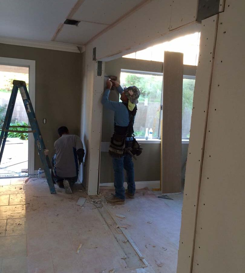 Construction of the replacement of a load bearing wall with a beam. Drywall has been applied to the timber and needs to be finished off with sanding and paint. Pacificland Constructors