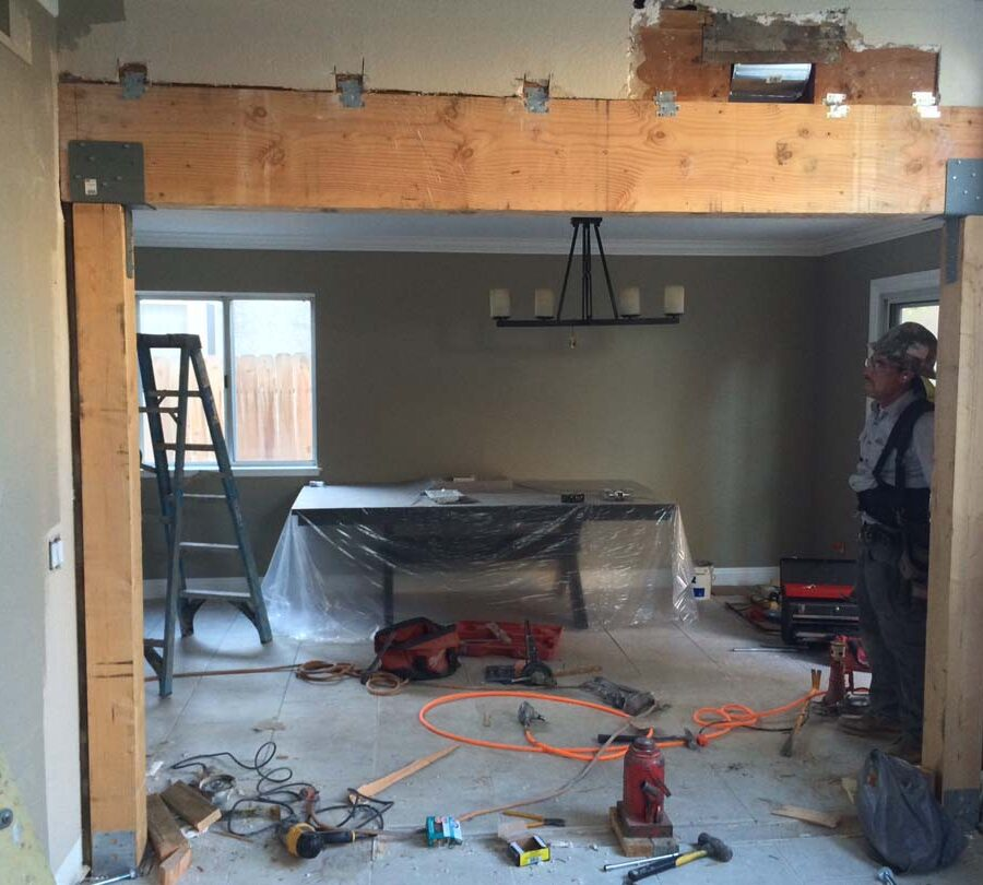 Construction of the replacement of a load bearing wall with a beam. Here the framework has been installed. Pacificland Constructors