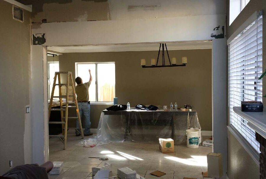 Construction of the replacement of a load bearing wall with a beam. Plaster and drywall has been applied to the timber and needs to be finished off with sanding and paint. Pacificland Constructors