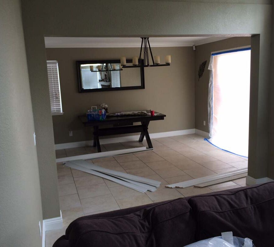Finished view of the replacement of a load bearing wall with a beam. The beam has been concealed with drywall, plaster, and paint. Pacificland Constructors