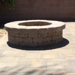 This outdoor fire pit is made with concrete pavers.