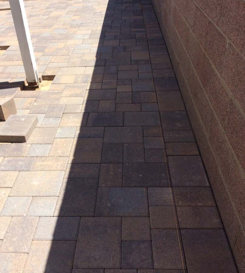 New paver concrete backyard patio for a residential project.