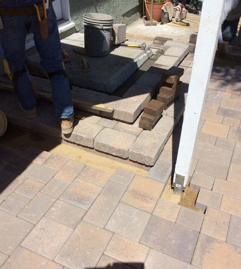 Construction of a new backyard porch landing.