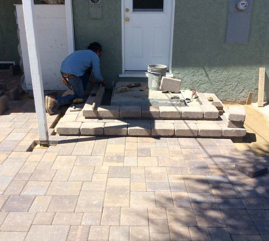 New paver concrete backyard patio, steps, and landing for a residential project.