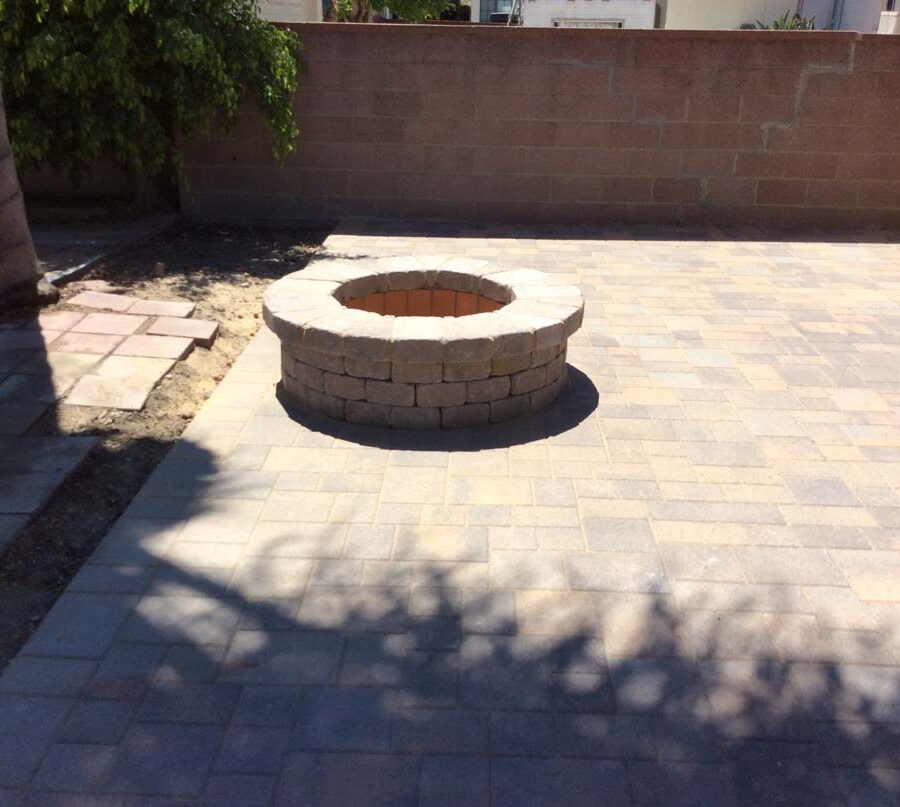 New paver concrete backyard and firepit for a residential project.