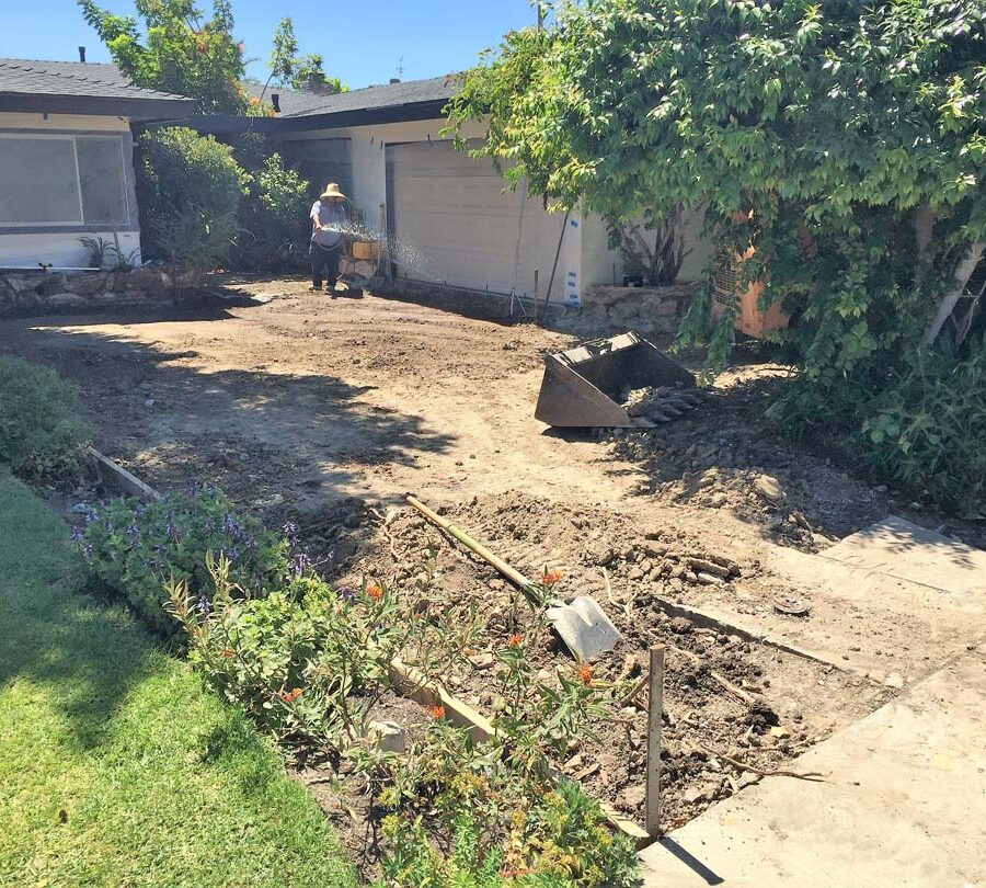 Grading for a new front yard patio with gaps used to create an architecturally nature-friendly theme. Pacificland Constructors