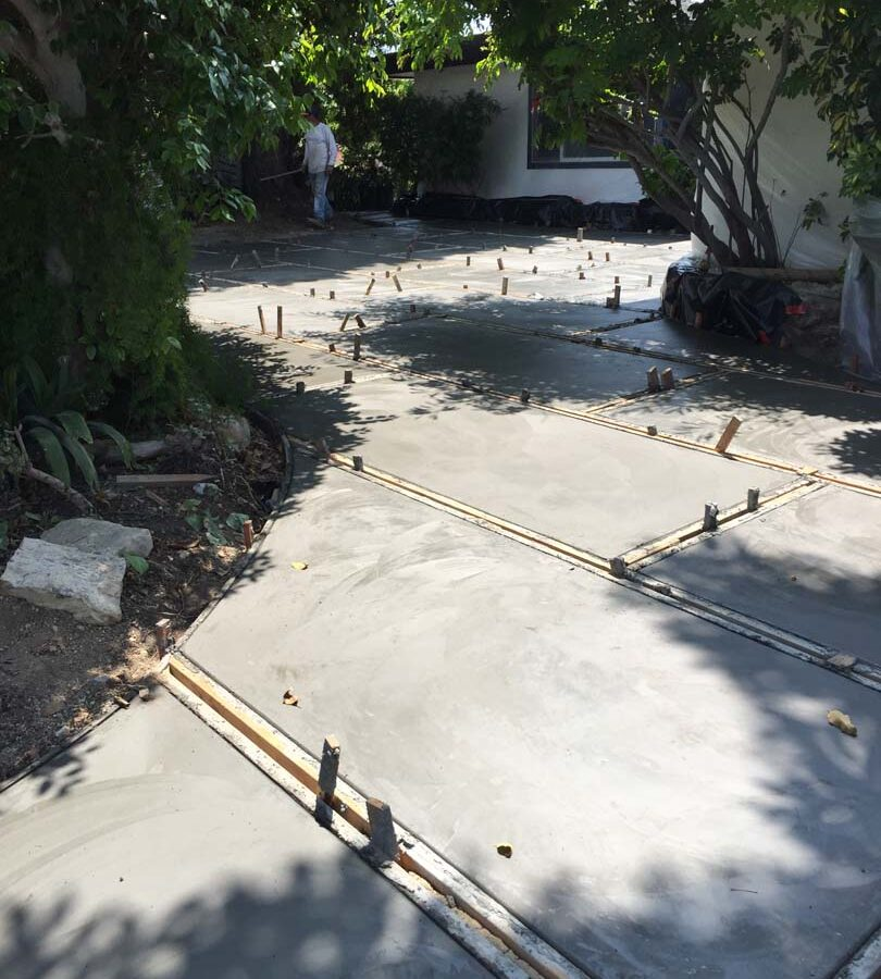 Construction of a new front yard patio used to create an architecturally nature-friendly theme. Pacificland Constructors