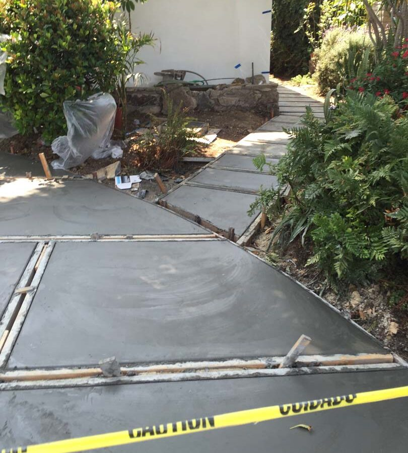 Pouring of a new front yard patio used to create an architecturally nature-friendly theme. Pacificland Constructors
